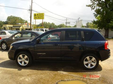 2013 Jeep Compass for sale at A-1 Auto Sales in Conroe TX