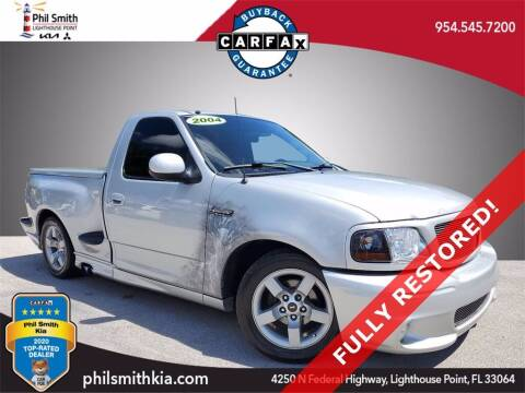 2004 Ford F-150 SVT Lightning for sale at PHIL SMITH AUTOMOTIVE GROUP - Phil Smith Kia in Lighthouse Point FL