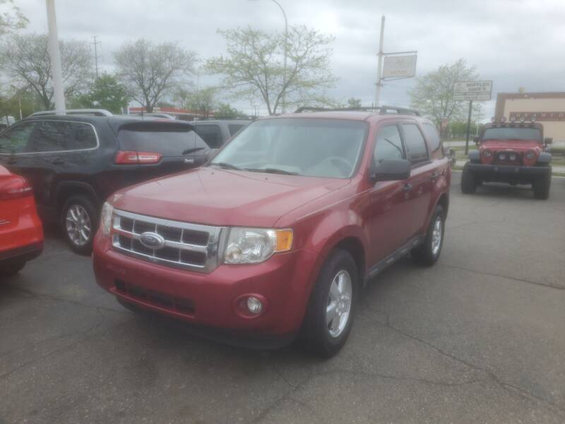 2009 Ford Escape for sale at J & J Used Cars inc in Wayne MI