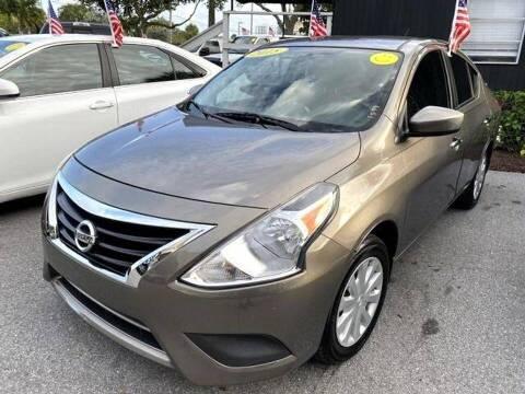2015 Nissan Versa for sale at EZ Own Car Sales of Miami in Miami FL