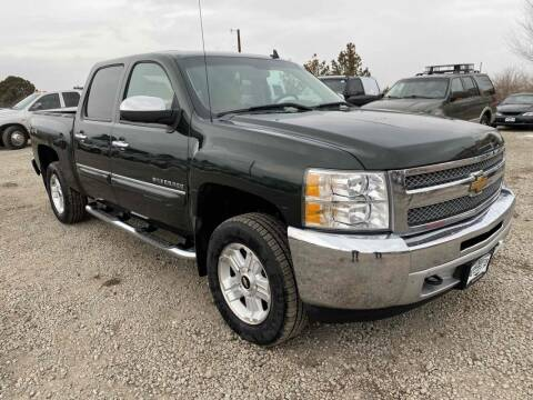 2013 Chevrolet Silverado 1500 for sale at BERKENKOTTER MOTORS in Brighton CO