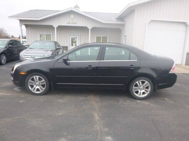2006 Ford Fusion for sale at JIM WOESTE AUTO SALES & SVC in Long Prairie MN