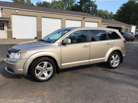 2009 Dodge Journey for sale at Jim's Hometown Auto Sales LLC in Byesville OH