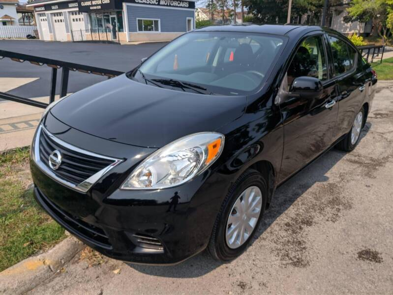 2014 Nissan Versa for sale at CLASSIC MOTOR CARS in West Allis WI