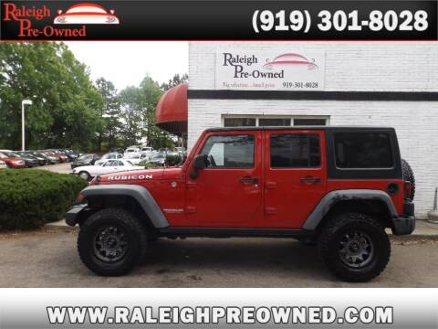 2012 Jeep Wrangler Unlimited for sale at Raleigh Pre-Owned in Raleigh NC