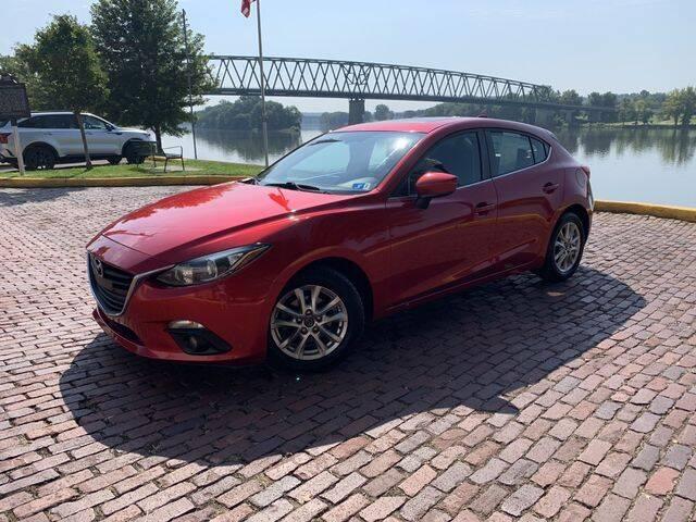 2015 Mazda MAZDA3 for sale at PUTNAM AUTO SALES INC in Marietta OH