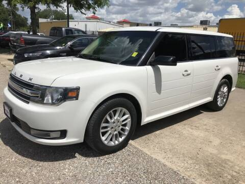 2013 Ford Flex for sale at AMIGO USED CARS in Houston TX