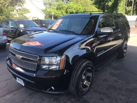 2011 Chevrolet Suburban for sale at Magic Motors Inc. in Snellville GA
