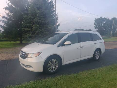 2014 Honda Odyssey for sale at Carmart Auto Sales Inc in Schoolcraft MI