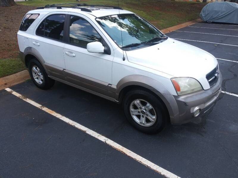 2004 Kia Sorento for sale at Magwood Auto Dealers LLC in Jonesboro GA