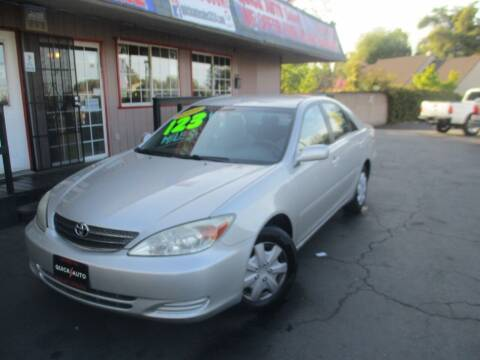 2004 Toyota Camry for sale at Quick Auto Sales in Modesto CA
