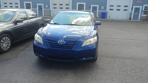 2009 Toyota Camry for sale at Pool Auto Sales Inc in Spencerport NY