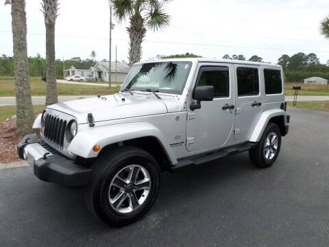 2011 Jeep Wrangler Unlimited for sale at First Choice Auto Inc in Little River SC