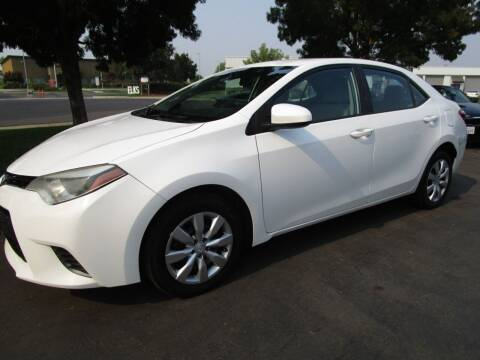 2015 Toyota Corolla for sale at KM MOTOR CARS in Modesto CA