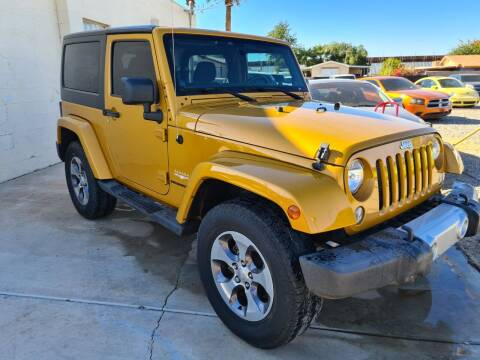 2014 Jeep Wrangler for sale at A AND A AUTO SALES in Gadsden AZ