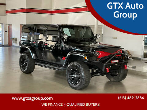 2013 Jeep Wrangler Unlimited for sale at UNCARRO in West Chester OH