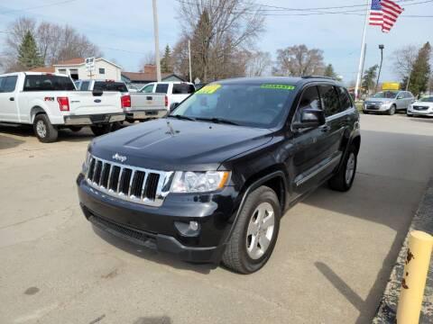 2012 Jeep Grand Cherokee for sale at Clare Auto Sales, Inc. in Clare MI