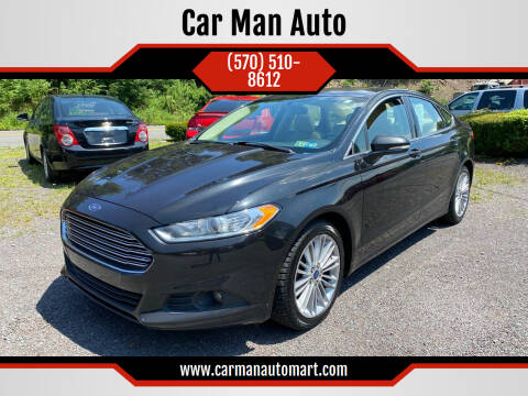 2014 Ford Fusion for sale at Car Man Auto in Old Forge PA