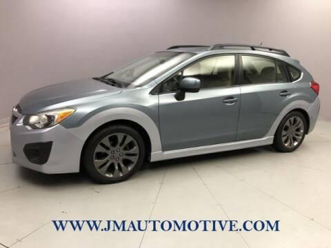 2012 Subaru Impreza for sale at J & M Automotive in Naugatuck CT