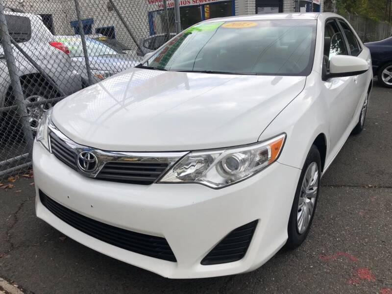 2013 Toyota Camry for sale at DEALS ON WHEELS in Newark NJ