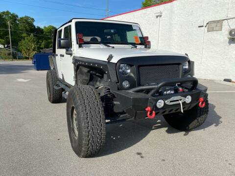 2015 Jeep Wrangler Unlimited for sale at Consumer Auto Credit in Tampa FL