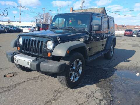 2010 Jeep Wrangler Unlimited for sale at Merrimack Motors in Lawrence MA
