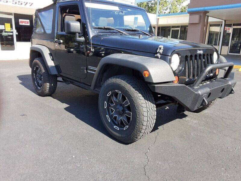 2012 Jeep Wrangler for sale at 2020 AUTO LLC in Clearwater FL