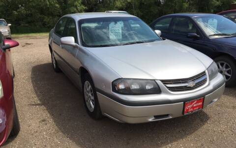 2005 Chevrolet Impala for sale at BARNES AUTO SALES in Mandan ND