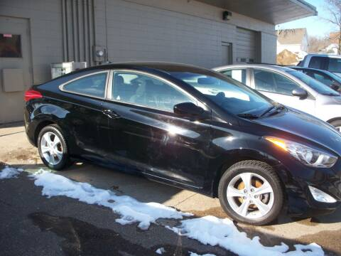 2013 Hyundai Elantra Coupe for sale at North Metro Auto Sales in Cambridge MN