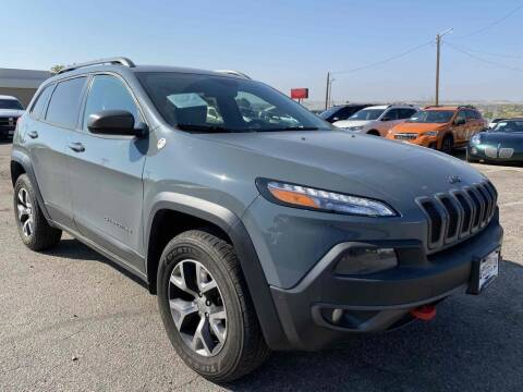 2014 Jeep Cherokee for sale at BERKENKOTTER MOTORS in Brighton CO