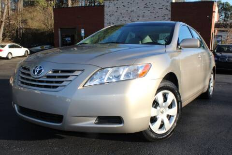 2009 Toyota Camry for sale at Atlanta Unique Auto Sales in Norcross GA