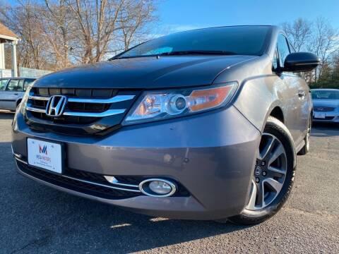 2014 Honda Odyssey for sale at Mega Motors in West Bridgewater MA