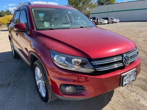 2012 Volkswagen Tiguan for sale at BERKENKOTTER MOTORS in Brighton CO