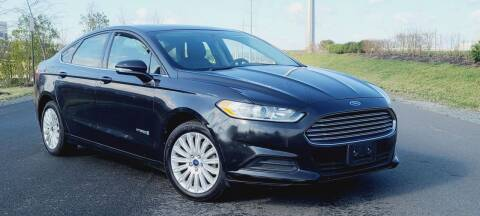 2013 Ford Fusion Hybrid for sale at BOOST MOTORS LLC in Sterling VA