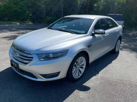 2014 Ford Taurus for sale at Triangle Motors Inc in Raleigh NC