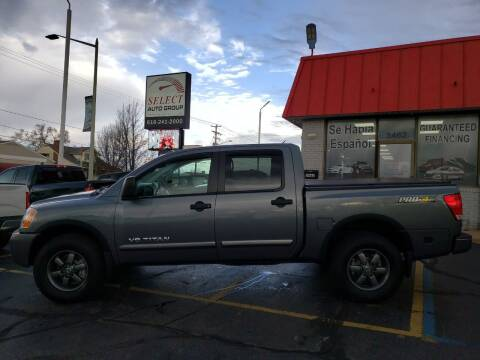 2013 Nissan Titan for sale at Select Auto Group in Wyoming MI