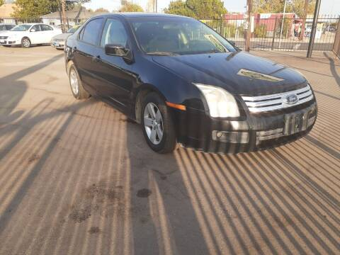 2007 Ford Fusion for sale at COMMUNITY AUTO in Fresno CA