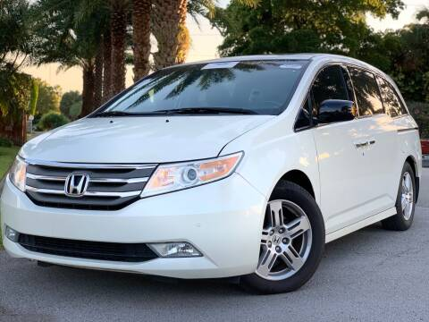 2012 Honda Odyssey for sale at HIGH PERFORMANCE MOTORS in Hollywood FL