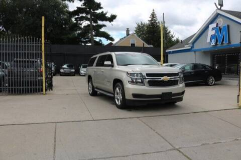 2015 Chevrolet Suburban for sale at F & M AUTO SALES in Detroit MI