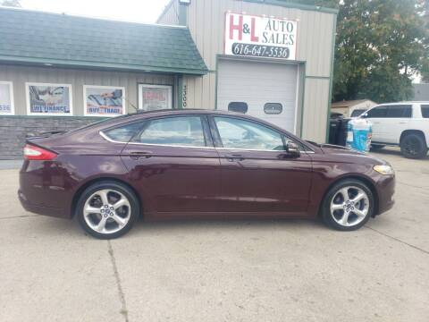 2013 Ford Fusion for sale at H & L AUTO SALES LLC in Wyoming MI