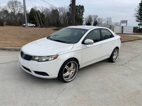2013 Kia Forte for sale at Two Brothers Auto Sales in Loganville GA