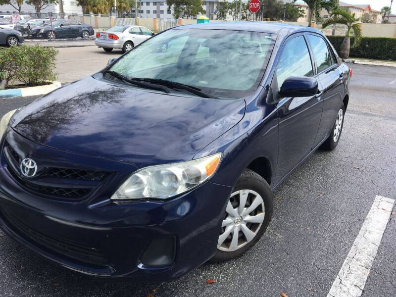 2013 Toyota Corolla for sale at LESS PRICE AUTO BROKER in Hollywood FL