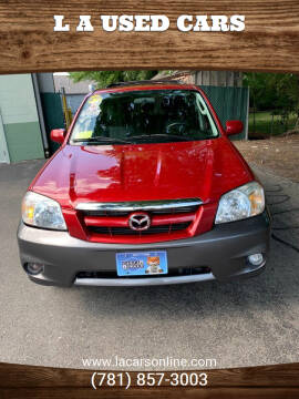 2006 Mazda Tribute for sale at L A Used Cars in Abington MA