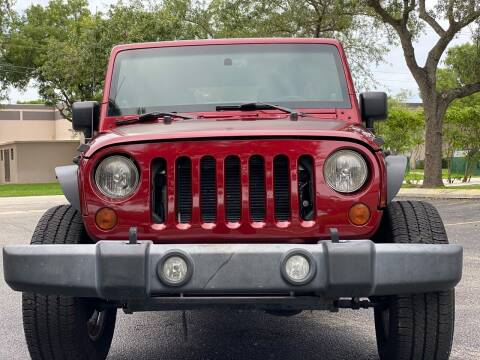 2013 Jeep Wrangler Unlimited for sale at HIGH PERFORMANCE MOTORS in Hollywood FL