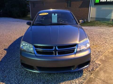 2013 Dodge Avenger for sale at ADKINS PRE OWNED CARS LLC in Kenova WV