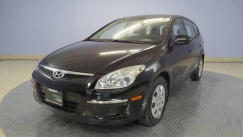 2011 Hyundai Elantra Touring for sale at Hagan Automotive in Chatham IL