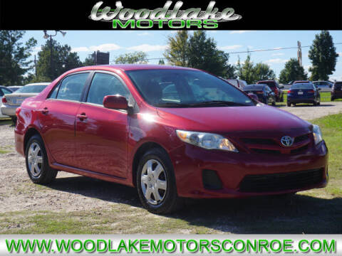 2011 Toyota Corolla for sale at WOODLAKE MOTORS in Conroe TX