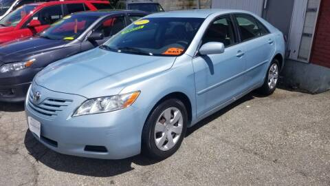 2007 Toyota Camry for sale at Howe's Auto Sales in Lowell MA