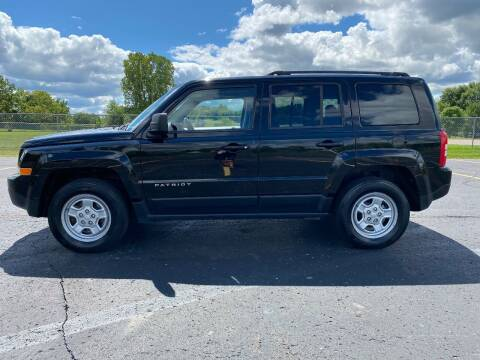 2013 Jeep Patriot for sale at Caruzin Motors in Flint MI