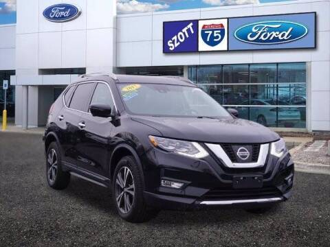 2017 Nissan Rogue for sale at Szott Ford in Holly MI